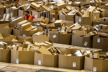 A worker stands between boxes at an Amazon distribution center during 'Black Friday' in Madrid, Spai...