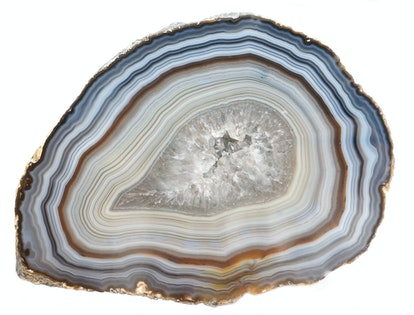 A banded Agate specimen with a geode of Quartz crystals