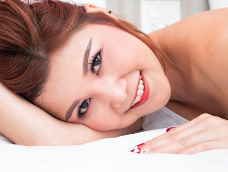 Smiling asian women on bed , Portrait asian women on bed