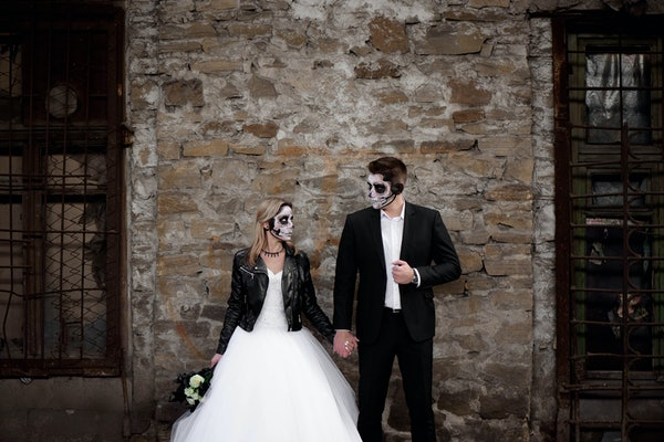 Halloween couple. Dressed in wedding clothes romantic zombie couple. Halloween concept. Fashion photo. Horror. Celebration.