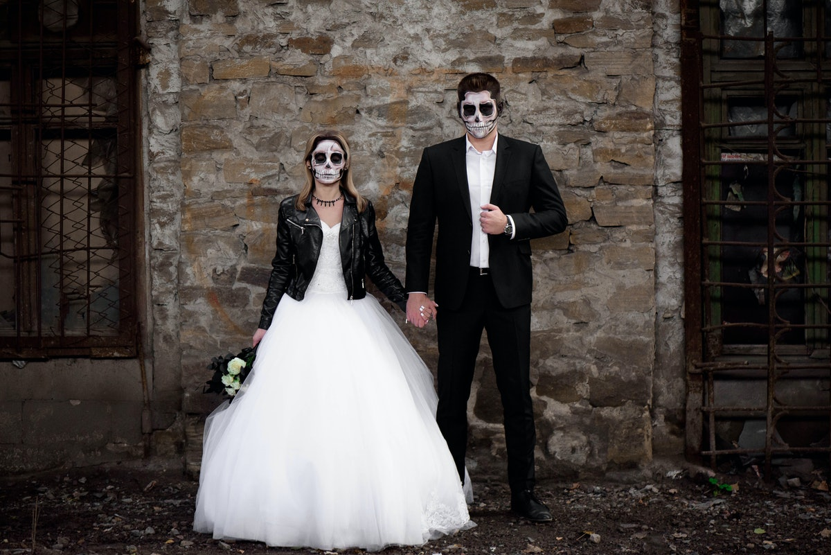 Halloween couple. Dressed in wedding clothes romantic zombie couple. Halloween concept. Fashion phot...