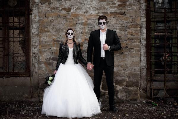 Halloween couple. Dressed in wedding clothes romantic zombie couple. Halloween concept. Fashion photo. Horror. Celebration.