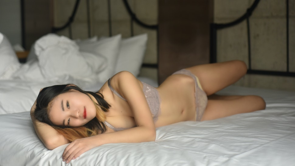 A woman in lingerie on the bed