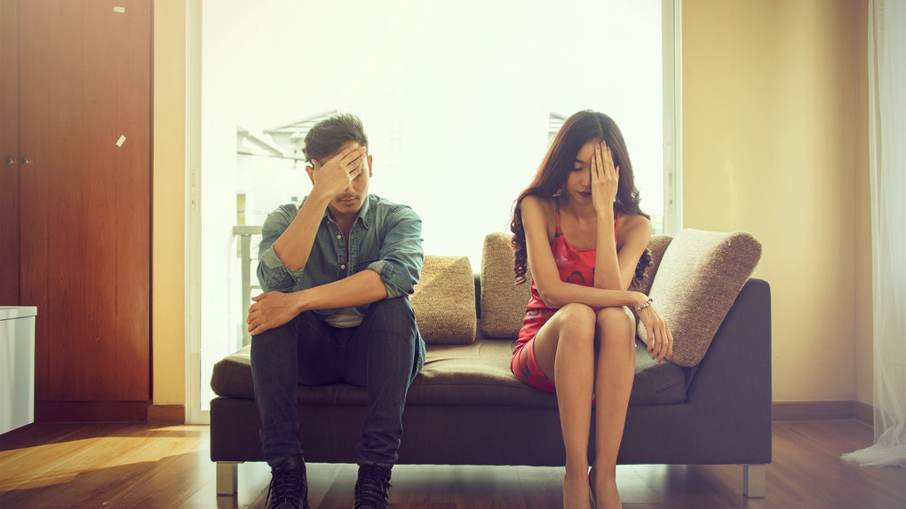Unhappy couple sitting on couch after quarrel fight thinking of break up or divorce, black upset man and woman not talking having conflict, bad relationships concept.