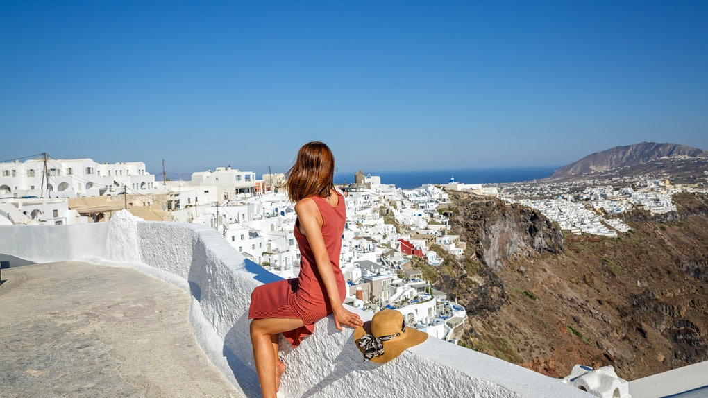 Young, beautiful woman in Greece, Santorini island, back view