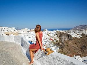 Young, beautiful woman in Greece, Santorini island, back view
