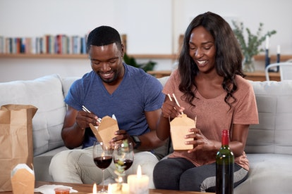 Couple enjoying food delivered by takeout app modern dining in and romantic date night