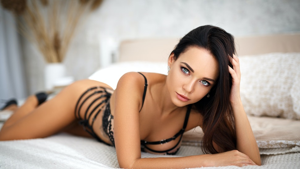 Beautiful young girl in a sexy black lingerie