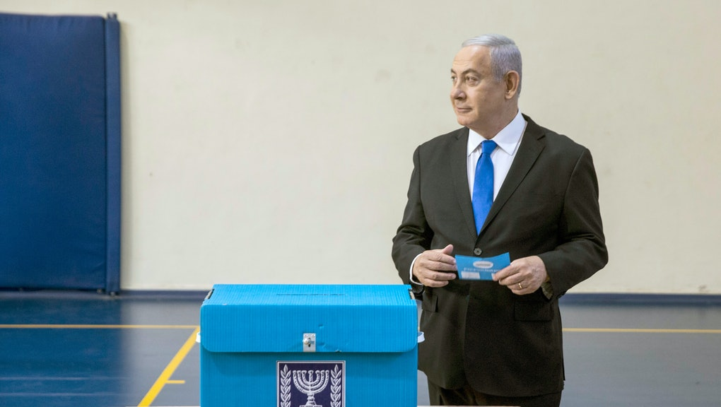 Israeli Prime Minister Benjamin Netanyahu prepares to cast his ballot during the Israeli legislative...
