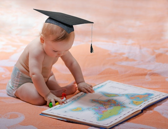 Baby with square academic cap and maps of the world