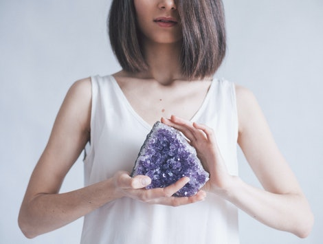 a girl with a big amethyst in her hands