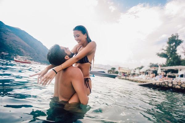 Sexy young couple on the beach having fun