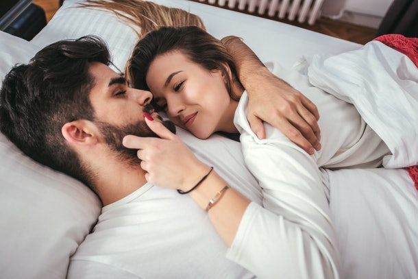 Young loving couple in the bed - people, family, bedtime and happiness concept