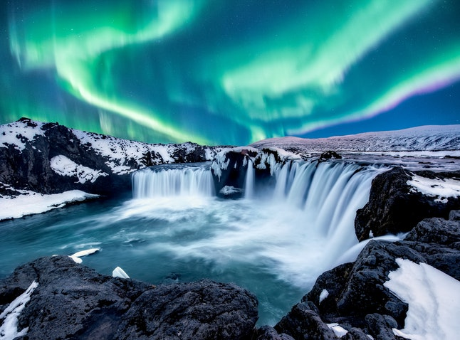 A wonderful night with Kp 5 . Northern lights The Godafoss is a waterfall in Iceland.