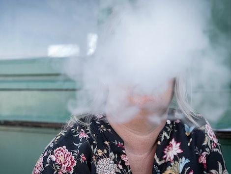 woman in vape haze on pier