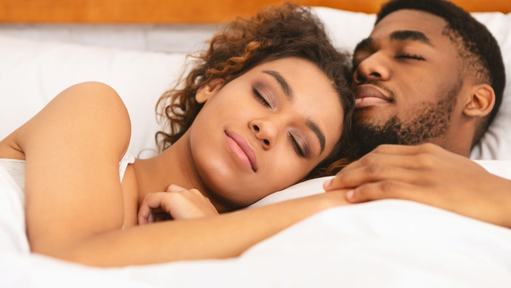 True love. Black couple sleeping together, cuddling in bed, closeup