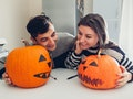 A couple making jack-o'-lanterns for Halloween may be in need of some cute pumpkin carving captions ...