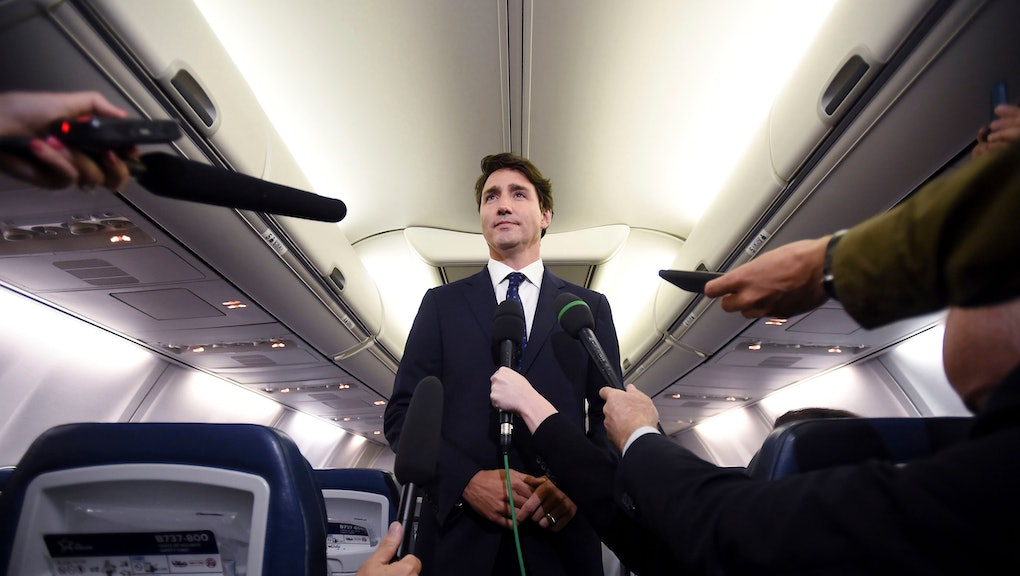 "Canadian Prime Minister and Liberal Party leader Justin Trudeau makes a statement in regards to a photo coming to light of himself from 2001, wearing ""brownface,"" during a scrum on his campaign plane in Halifax, Nova Scotia"