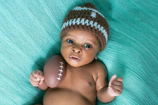 Newborn Baby Boy with Football
