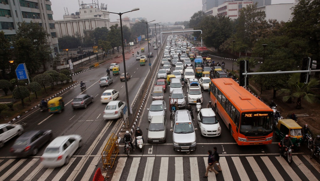 Traffic moves at dusk in New Delhi, India. When U.S. President Barack Obama visits New Delhi from Sunday, he will join the Indian capital's masses in breathing some of the world's filthiest air. Hazy skies will serve as the backdrop to meetings with Indian Prime Minister Narendra Modi and other officials who are expected to discuss India's biggest environmental woes: Heavy reliance on fossil fuels that has transformed New Delhi into the planet's most polluted capital and made India the third biggest national emitter of greenhouse gases