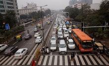 Traffic moves at dusk in New Delhi, India. When U.S. President Barack Obama visits New Delhi from Su...