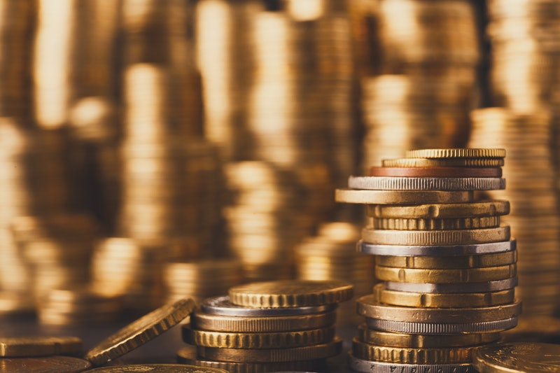 Golden coin stacks, rich money background. Financial success, cryptocurrency mining, banking and profit concept, selective focus