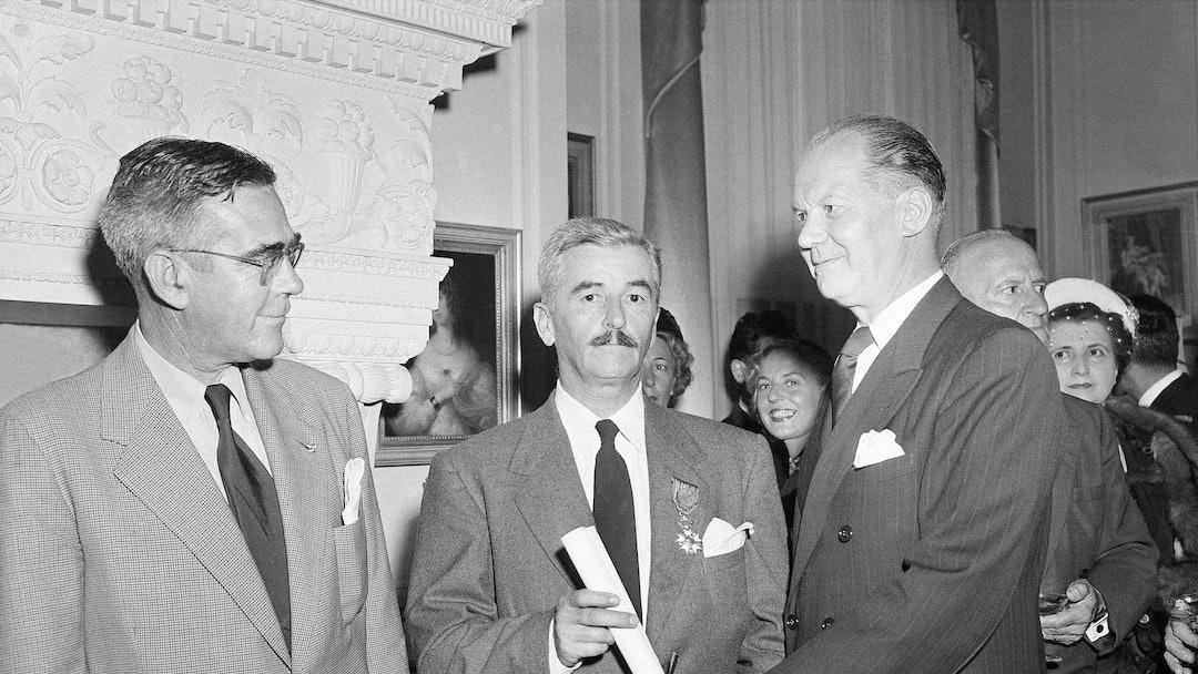William Faulkner From left to right are F. G. Strachan, Censul of Sweden; William Faulkner, of Oxfor...