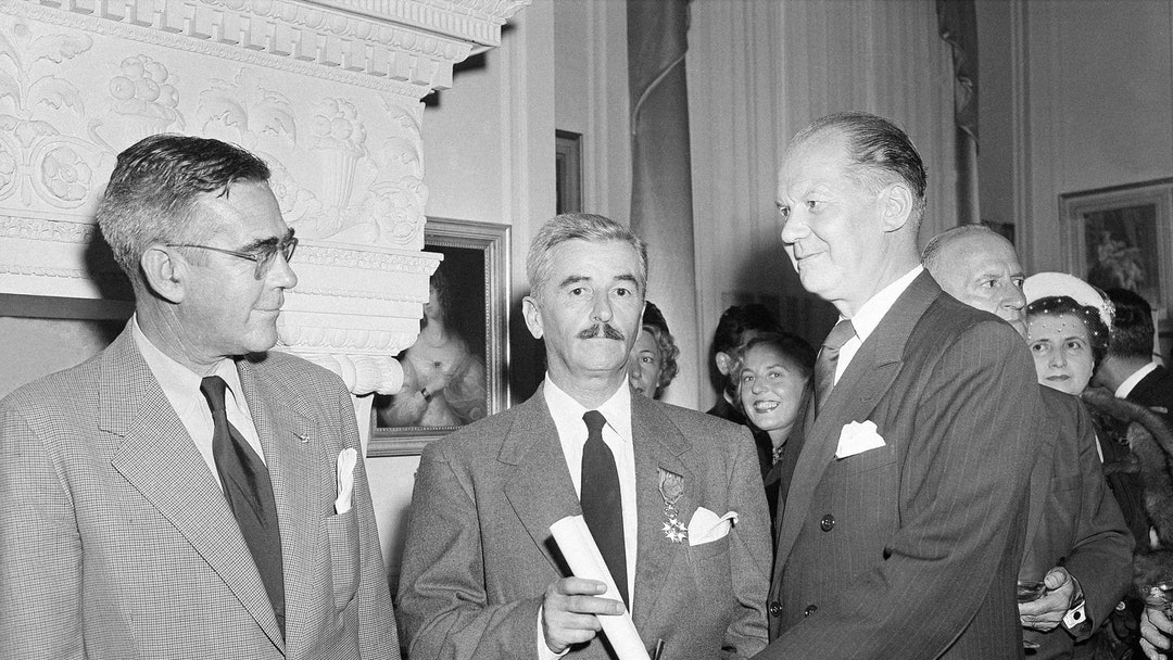 William Faulkner From left to right are F. G. Strachan, Censul of Sweden; William Faulkner, of Oxford, Miss., and French Consul Lionel Vasse, who made the presentation at a reception in New Orleans, where novelist William Faulkner was awarded the French Legion of Honor medal