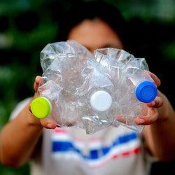 Women are recycling plastic garbage.