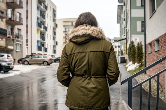 Lonely woman walking on the street, on a rainy day