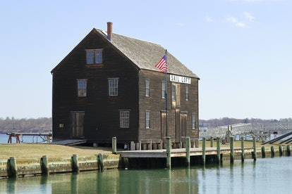 View of historic pier and timber sail loft building in Salem, Massachusetts