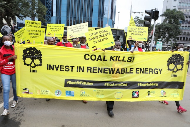 Kenyan activists hold placards and shout slogans as they march during a protest against the proposed construction of a Coal Plant in Lamu, in central Nairobi, Kenya, 12 June 2019. The Institute for Energy Economics and Financial Analysis said on 10 June 2019 that the 981-megawatt facility would cost Kenyan consumers more than nine billion US dollars even if it does not generate any power. Although the construction of a coal-fired power plant in Lamu county hasn't began yet, activists say Kenya should adopt renewable sources of energy such as geothermal, hydro, wind and solar power.