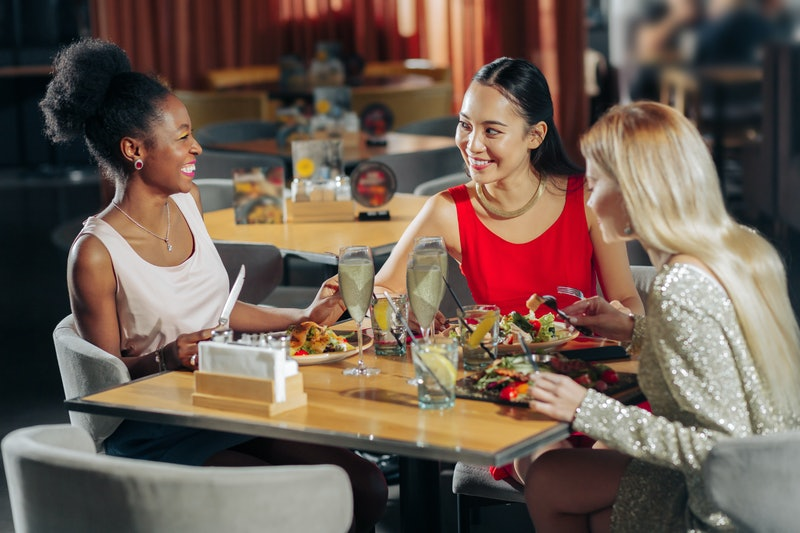 Woman laughing. African-American woman laughing while spending evening with friends