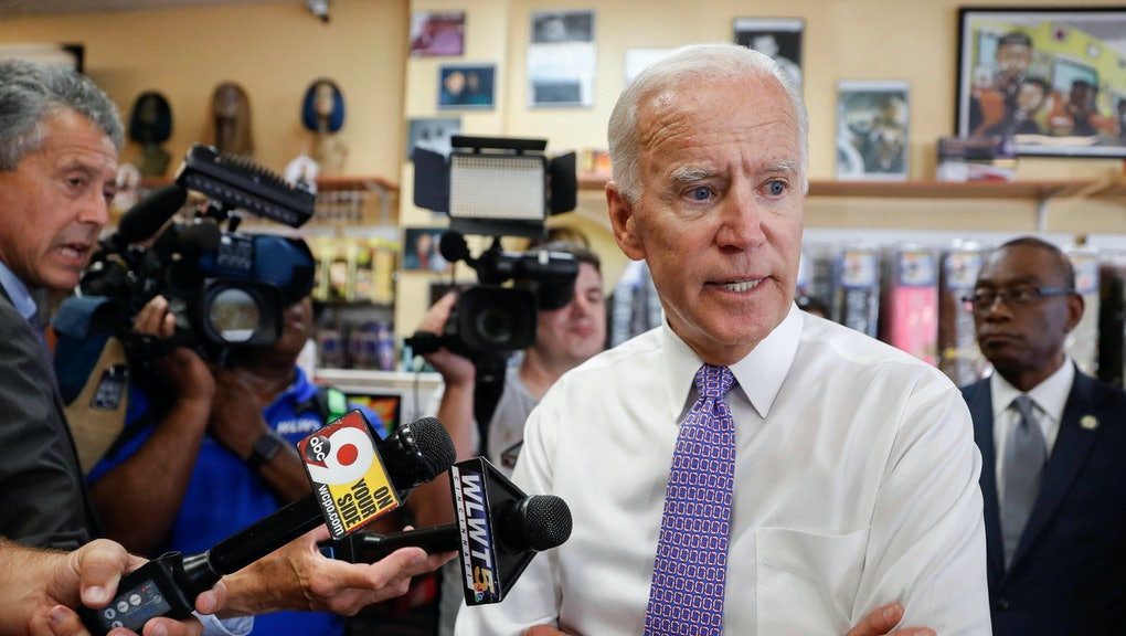 """Former Vice President Joe Biden speaks to the media during a campaign stop with Democratic gubernatorial candidate Richard Cordray at the Beyond Image Barber Salon, in Cincinnati. Former Vice President Joe Biden is urging Americans to """"rise up"""" to demand President Donald Trump nominate a """"consensus candidate"""" to the Supreme Court. Biden sided with Democrats who have said the Senate should postpone the confirmation process until after the mid-term elections. He said, """"so many of our fundamental rights, freedoms, and liberties, and the rule of law, are all at risk"""