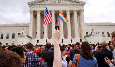 A man holds a U.S. and a rainbow flag outside the Supreme Court in Washington after the court legalized gay marriage nationwide. A federal appeals court ruled Friday that the Supreme Court can keep protesters off its marble plaza without violating their constitutional right to free speech. The U.S. Court of Appeals for the District of Columbia Circuit said that First Amendment rights stop at the sidewalk in front of the majestic courthouse and do not extend to the plaza