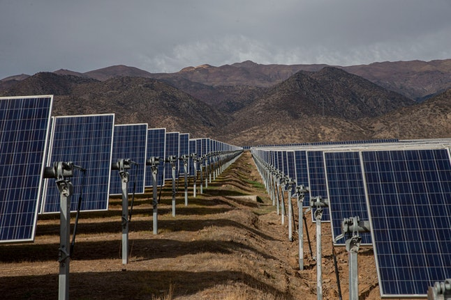 Solar panels stand in the Quilapilún photovoltaic plant, a joint venture by Chile and China, in Coli...