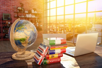 Languages learning and translate, communication and travel concept, books with covers in colors of f...