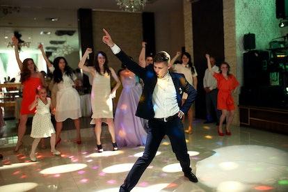 The groom dancing on the dancefloor