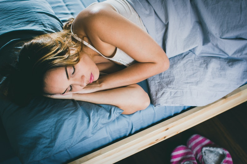 Woman sleeping at home