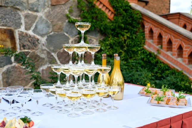 Champagne glass pyramid. Pyramid of glasses of wine, champagne, tower of champagne on wedding party.  For festive reception at the wedding on table