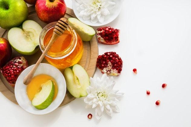 Apples, honey, pomegranate. Jewish New Year table set