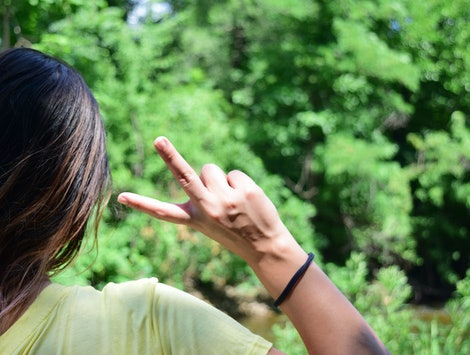 Peace Sign Girl in Nature