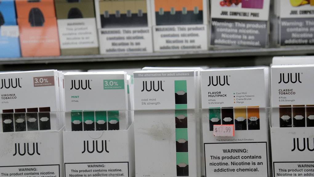 Juul products are displayed at a smoke shop in New York, . Altria, one of the world's biggest tobacco companies, is spending nearly $13 billion to buy a huge stake in the vape company Juul as cigarette use continues to decline