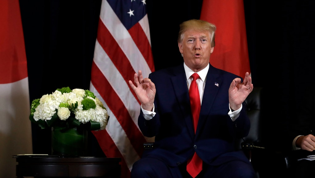 President Donald Trump talks while meeting with Japanese Prime Minister Shinzo Abe at the InterConti...