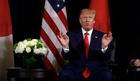 President Donald Trump talks while meeting with Japanese Prime Minister Shinzo Abe at the InterContinental Barclay New York hotel during the United Nations General Assembly, in New York