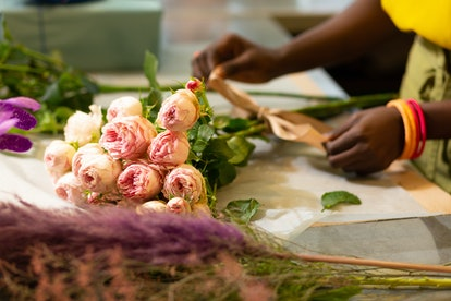 For wedding ceremony. Professional florist standing at her place while composing flowers