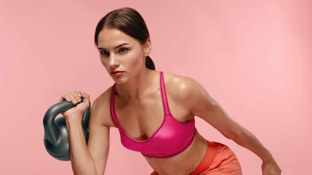 Workout. Woman Training With Dumbbell On Pink Background
