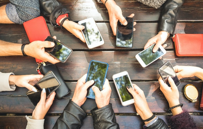 People group having addicted fun together using smartphones - Detail of hands sharing content on soc...