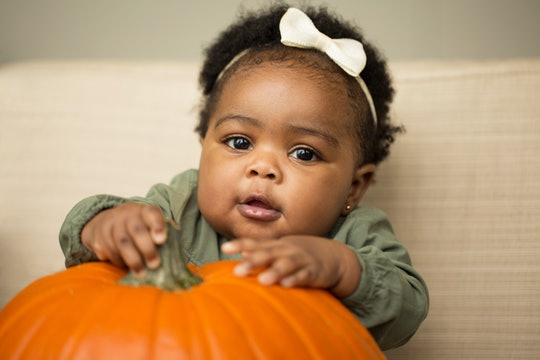 Cute little girl with a pumpkin.