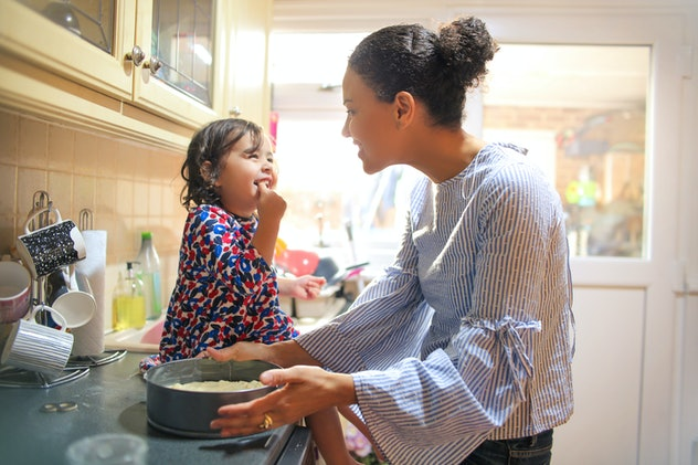 Sweet mother and daughter cooking together
